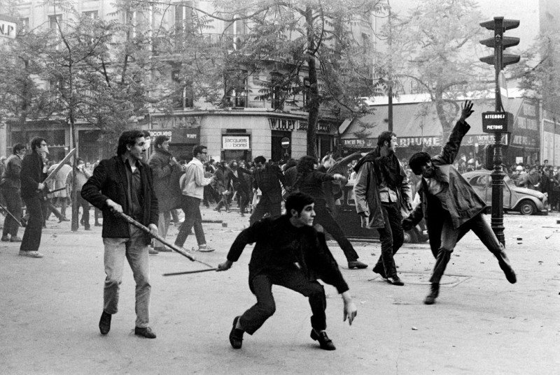 FRANCE. Paris. May 6th 1968. 6th arrondissement. Boulevard Saint Germain. Students hurling projectiles against the police.